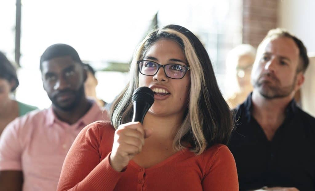 woman using voice to challenge the status quo
