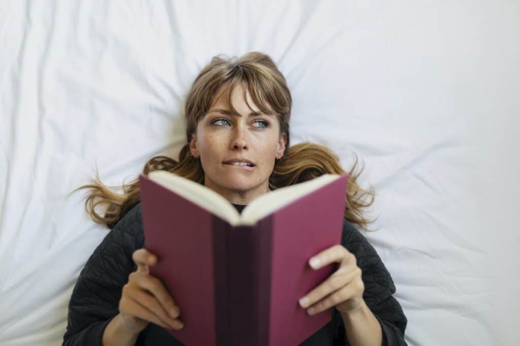 Woman reads book and contemplates response