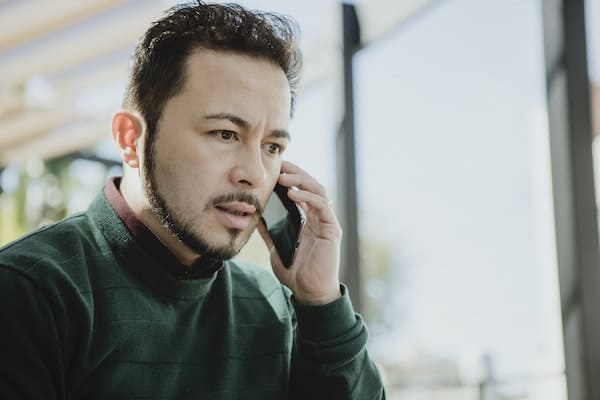 man hearing other's feelings on call