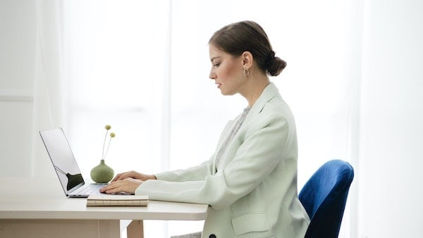 Woman investing on laptop